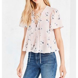Urban Outfitters pink lace up short-sleeve blouse